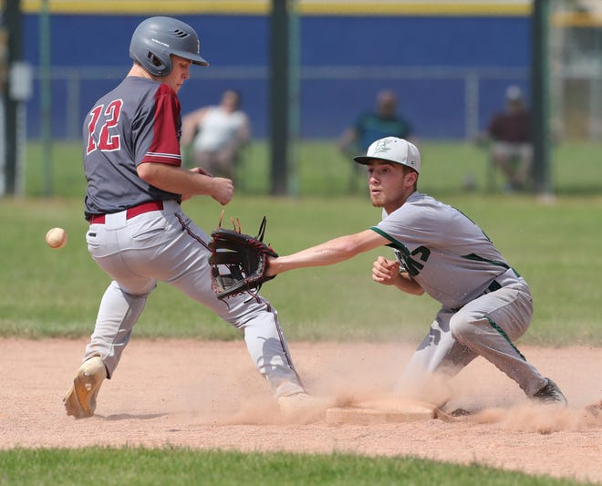Nordonia shortstop Rocco Covelli reaches for the ball on a pickoff attempt on Dover's Tyler Little in a Division I district semifinal game on Tuesday in Euclid. Dover won 15-0. [Phil Masturzo/Beacon Journal]