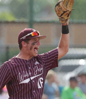 Walsh Jesuit's Henry Kaczmar celebrates during a six-run first inning in a 13-1 win over Hudson in a Division I district semifinal on Tuesday in Euclid. [Phil Masturzo/Beacon Journal]