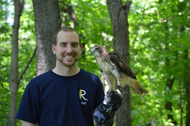 Josh Kuszmaul holds one of the residents of the soon-to-be opened Raptor Hallow Sanctuary at Beech Creek Botanical Garden and Nature Preserve.