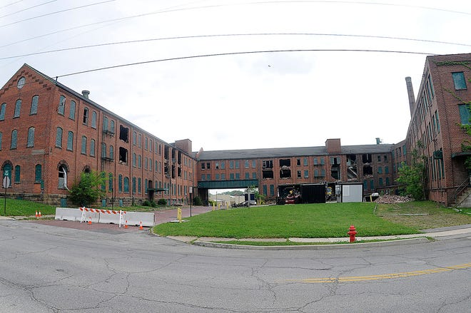 Equipment for demolishing the old Hess & Clark Building sits in the parking lot on Wednesday, May 26, 2021. TOM E. PUSKAR/TIMES-GAZETTE.COM