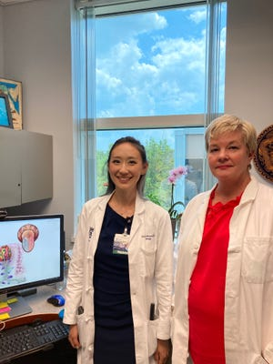 Dr. Elizabeth Rutkowski, left, and Dr. Lynnette McCluskey are following COVID-19 patients in Georgia in a long-term study that has already found some suffering ongoing problems from the infection.