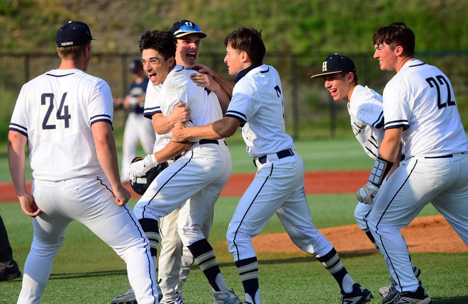 Hopewell baseball players celebrate their WPIAL AAA semifinal win over McGuffey Tuesday at West Mifflin High School. The Vikings are headed to the WPIAL championship next week. [Lucy Schaly/For BCT]