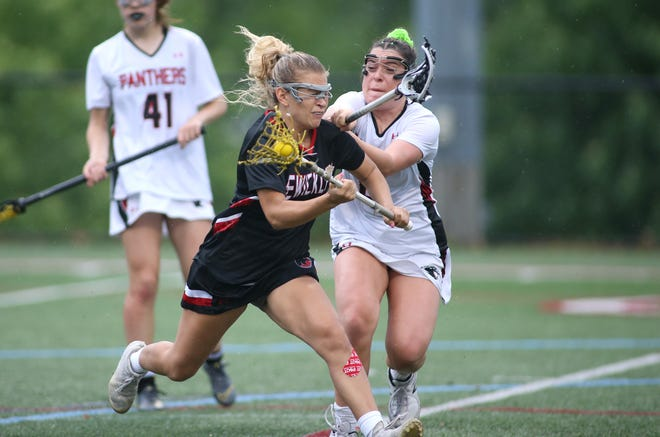 Sewickley Academy's Emma DiSantis (left) gets pushed around by Upper Saint Clairs Daniela Gibbons (right) while attacking the net during the second half of the WPIAL 3A Conciliation game last month at Joe Walton Stadium in Moon Township.