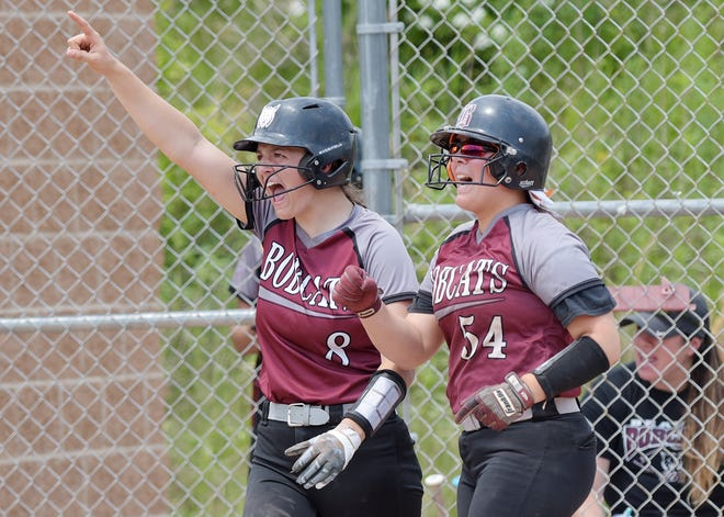 Beaver's Payton List and Mack Boyd cheer on the rest of their team after scoring a pair of runs during a WPIAL Class 4A semifinal game against West Mifflin, Wednesday at Peterswood Park. [Sally Maxson/For BCT]