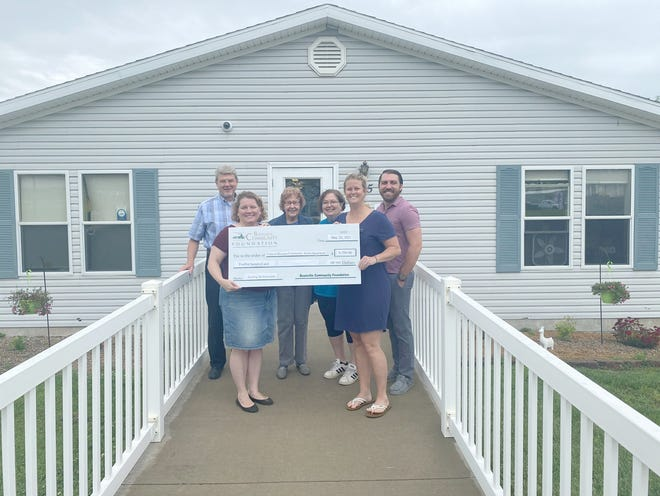 """The Boonville Community Foundation (BCF) presented Clubhouse Head Start a check to install a new awning for their building entrance.  """"Because of COVID we were meeting families outside, taking temps, getting paperwork signed, and those regular conversations, rainy days are rough.  We had an umbrella but the wind destroyed it.  On the very day we needed it, we couldn't use it because the wind whipped it away,"""" stated Head Start Site Director Krescenz Hundley.  The new awning will allow the program to have a dry outdoor place to conduct such business should the need arise again in the future. Pictured are John Baker (BCF), Laura Wax (BCF), Phyllis Reesman (BCF), Krescenz Hudnley (Head Start), Beth Vossler (Head Start), and Evan Melkersman (BCF)."""