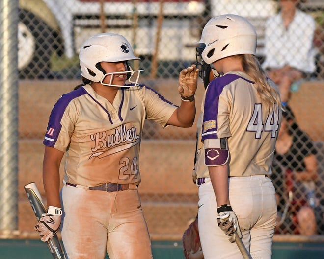 Ari Cordova (24) and Anna Icenhower (44) go in for the high-5 in Butler's 10-2 win over Trinity Valley Community College on Tuesday, May 25 in the first round of the NJCAA D1 Softball Championships in Yuma, Arizona.