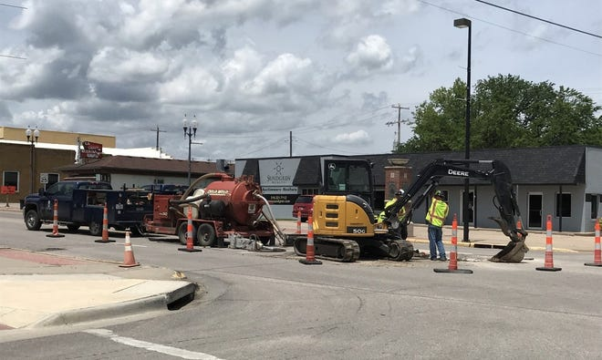 Workers repairing a water leak at the intersection of Central and Griffith in El Dorado