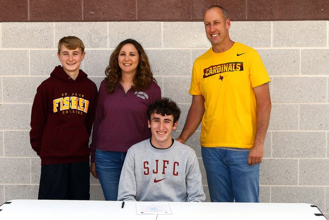 Dundee High School senior Steven Webster recently signed on to attend St. John Fisher College to play basketball next year. With him are his brother, Aidan, and mother and father, Melanie and Jared.