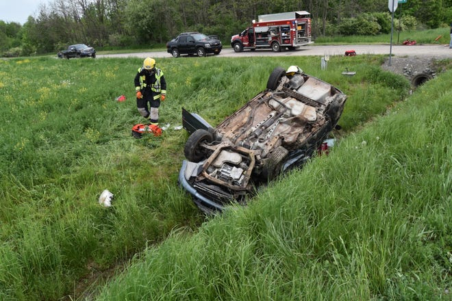 Emergency responders rescued four people trapped in this overturned car May 22 in Jerusalem.