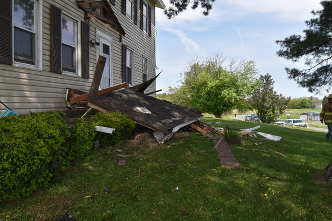 A suspected drugged and unlicensed driver was responsible for the damage to this house on Fergusons Corners Road May 19.