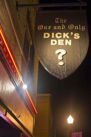 The sign outside of the Old North bar Dick's Den