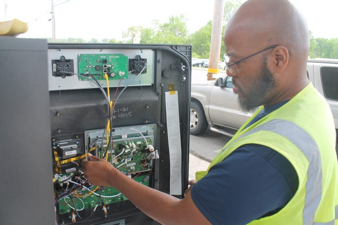 Derrick Bradley, deputy sealer in the weights and measures unit at the Franklin County Auditor's Office, checks the computerized inner workings of a gas pump on Wednesday at a Marathon station on Westerville Road, just north of Route 161 in Blendon Township.