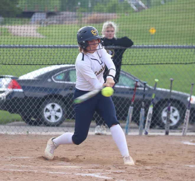 Emma Boll connects with a pitch in a game against Sacred Heart on May 25. Boll, playing in the final game of her career Tuesday against Roseau, went 1-for-2.