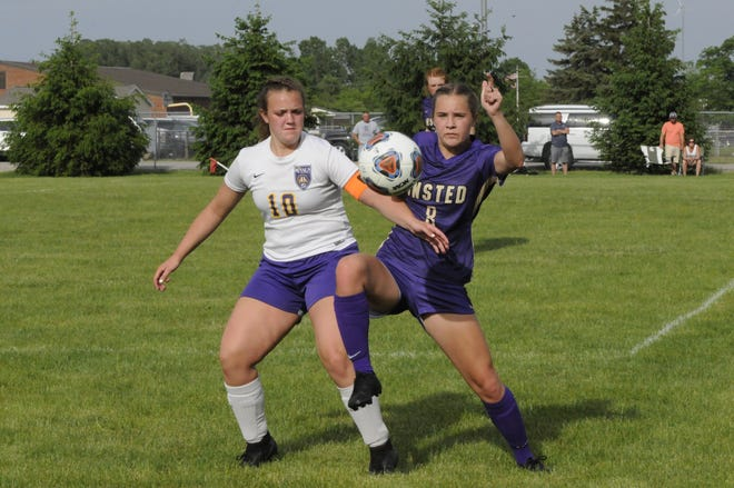 Blissfield's Kara Stutzman and Onsted's Bailey Brandly battle for a ball during Tuesday's game at Onsted.