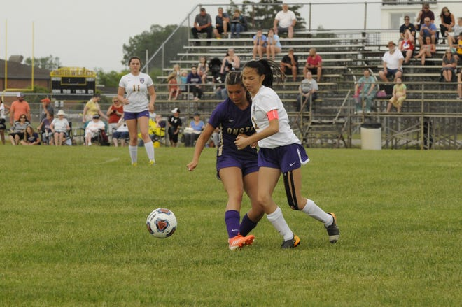 Blissfield's Meilin Hudson and Onsted's Elizabeth Hill both go for the ball during a game Tuesday in Onsted.