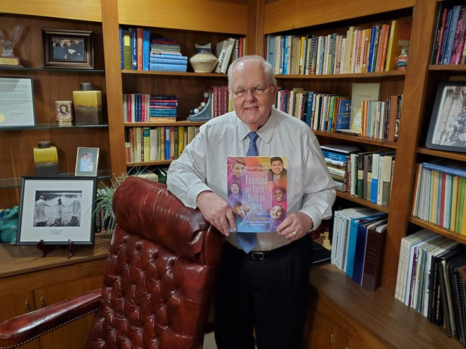 Dr. Michael Blackwell holds a copy of his recently released sixth book which dives into the past 20 years of history and change at The Baptist Children's Homes of North Carolina. He has served as president and CEO of the nonprofit, which is based in Thomasville, for 38 years.