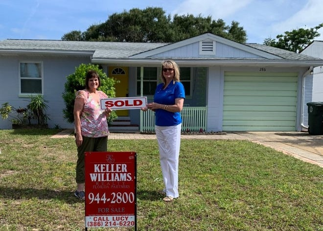 Realtor Alisa Rogers, right, holds a sold sign with Pamela Groome, the client she recently helped buy this beachside house on Williams Road in Daytona Beach, pictured on May 20, 2021. Rogers is an associate broker with 1st Florida Realty as well as the 2021 president of the Daytona Beach Area Association of Realtors. The property's listing agent was Lucy Hanner of Keller Williams Realty Florida Partners in Port Orange.