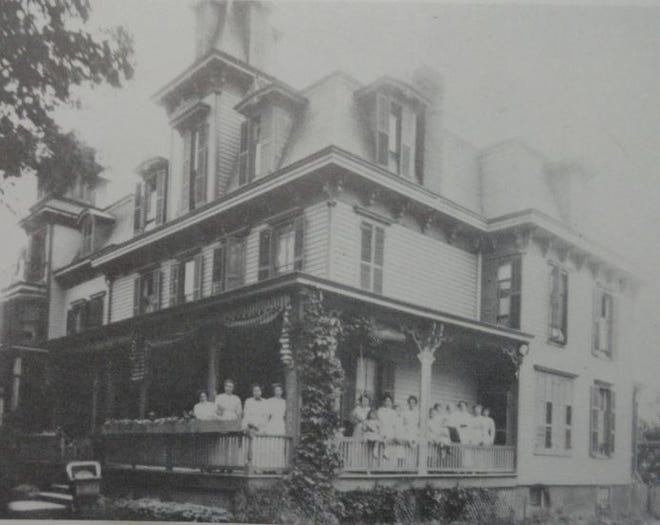 Tom Quick Inn, 411-409 Broad St., Milford, Pa., was built in the 1880's as two separate lodging houses, owned by the same family. The Centre Square Hotel, at left, and the Terwilliger House, at right, were joined in 1950 and renamed as the Tom Quick Inn./  Milford, Pa. Heritage 250 /Skip Gregory