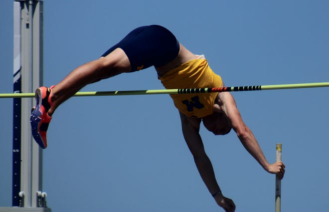 Michigan freshman Henry Sheldon clears the bar during the men's pole vault at the NCAA East Preliminary track and field championships at the University of North Florida's Hodges Stadium on May 26, 2021. [Clayton Freeman/Florida Times-Union]