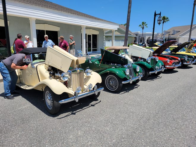 A line of classic MGs at the 11th Annual Rev It Up Car Show inFleming Island.