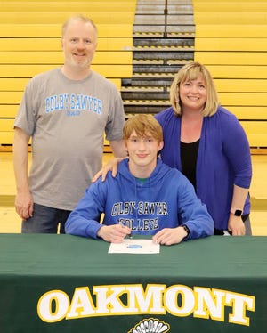 Oakmont senior Marty Steucek, pictured with his parents  Martin and Kendra Steucek at a recent signing ceremony in the Oakmont gymnasium, will continue his education and his athletic career at Colby-Sawyer College in New London, N.H., this fall.