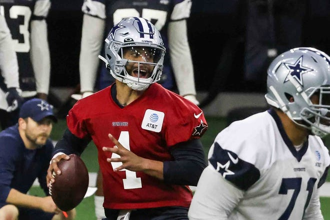 Quarterback Dak Prescott, 4, drops back to throw during the Cowboys' full-squad offseason workouts in Frisco on Tuesday.