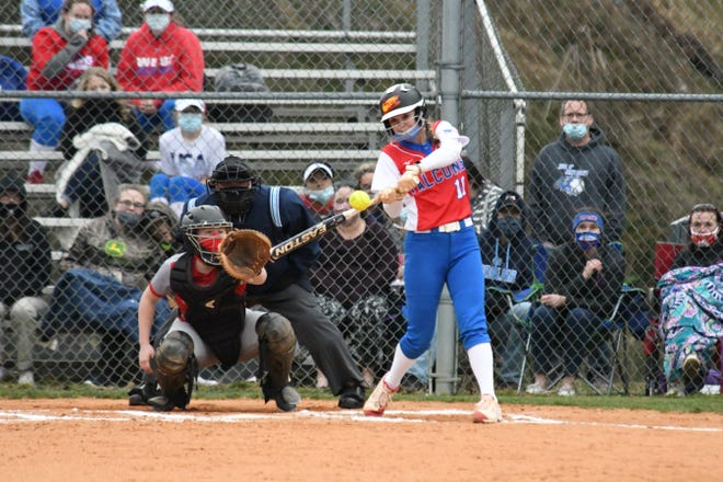 West Henderson's Megan Reese gets a hit during a game earlier this season at West.