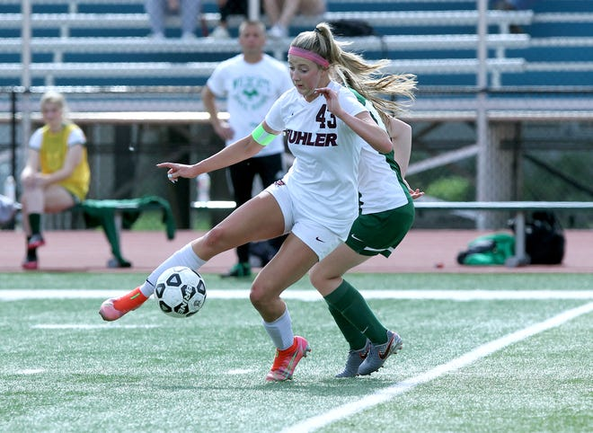 Buhler's Alexis Hutton (43) kicks the ball past Mulvane's Michaela Anderson (18) during their 4A Class quarterfinal game against Mulvane Tuesday evening. Mulvane defeated Buhler 2-1 (2-0) after four overtimes and penalty kicks.