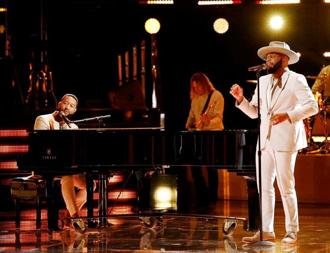 """John Legend, left, and Peoria High School graduate Victor Solomon perform Tuesday night on """"The Voice"""" on NBC. Solomon finished fifth in this season's competition."""