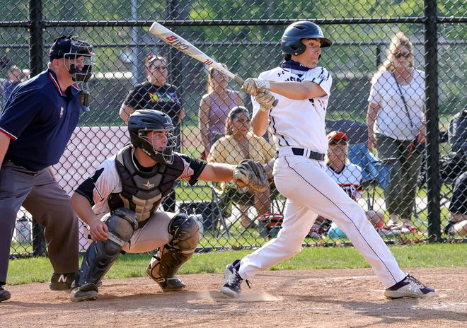 Hudson's Carter Buzzelli records a hit against Eastlake North on Thursday, May 20, 2021. Hudson won a sectional title, topping Eastlake North 7-4.