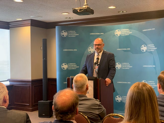 Lubbock Economic Development Alliance CEO and President John Osborne leads a news conference announcing new jobs an investment from Lubbock based companies Wednesday at the organization's headquarters downtown.