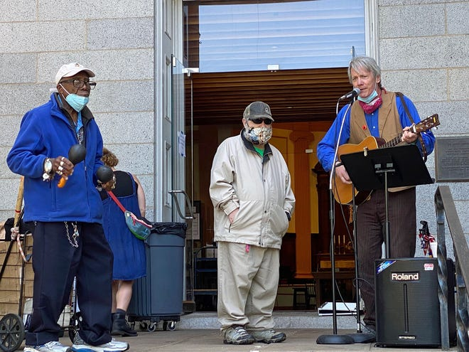 """Among the musicians entertaining guests at the Cathedral Church of St. Paul at 138 Tremont St. are, from left to right, Alex Gill, Eddie Atkins and Hall Kirkham. This was part of the MANNA (Many Angels Needed Now and Always) ministry. This is a ministry """"of and with the homeless community in downtown Boston."""" Visit www.stpaulboston.org for more information."""