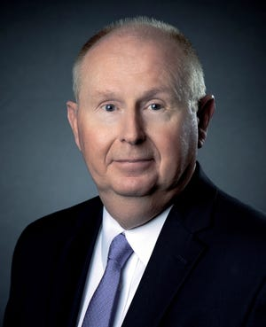 Ken Hughes will remain President and CEO of Merchants and Farmers Bank while assuming his new role as Chairman of the Board.