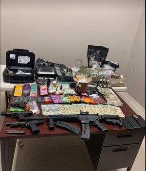 A search warrant resulted in the arrest of two men on narcotics and firearms charges.