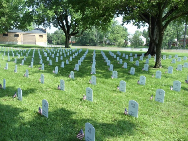 A photo of a past display of 800-plus faux tombstones that honors all of the war dead from Monroe County since 1813 is shown at Soldiers and Sailors Park in Monroe. The exhibit will again be available for public viewing this Memorial Day weekend starting at noon Saturday.