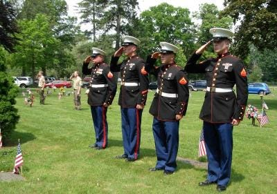 U.S. Marines stand at attention during the annual Memorial Day service held in the past at Roselawn Memorial Park cemetery in LaSalle.