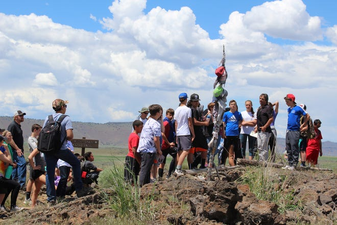 Mike Savarese talks with his seventh grade class in 2018 during a field trip to Captain Jack's Stronghold and Lava Beds National Monument. Savarese said he enjoyed sharing his passions with his students for the past 32 years, especially during field trips and through hands-on projects