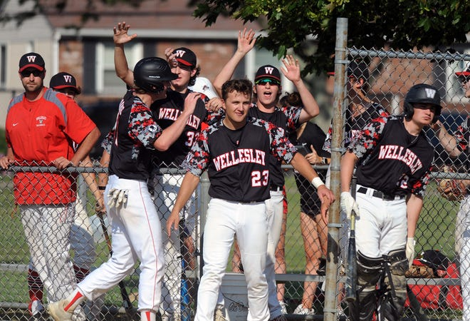 Wellesley High School baseball players celebrate during their game at Framingham, May 26, 2021.