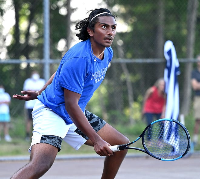 Ashland's Arjun Nair  eyes the ball with intensity during his first singles match against Dover-Sherborn's  Dan Pomahac during a showdown of undefeated players at Ashland Middle School, May 26, 2021. Nair prevailed in two sets, 6-2, 6-2.