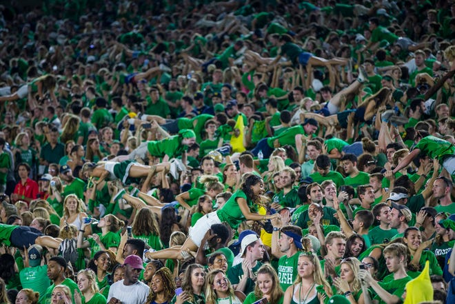 Notre Dame fans celebrate during the Notre Dame-Michigan football game on Saturday, Sept. 1, 2018 in Notre Dame Stadium.