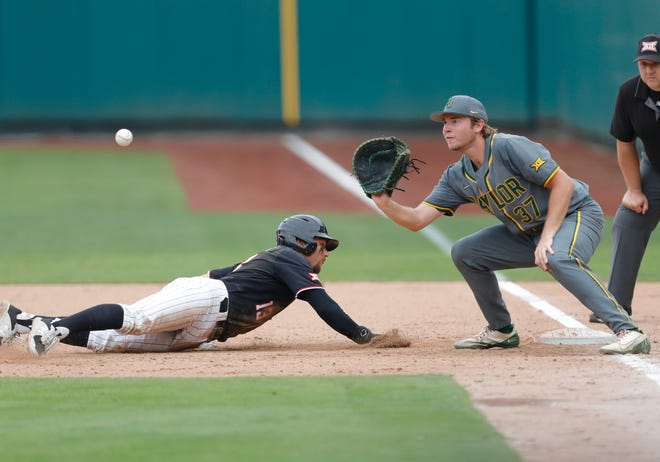 Texas Tech's Cal Conley (left) safely slides back to base ahead of a catch by Baylor first baseman Chase Wehsener during the Big 12 Conference Baseball Tournament on Wednesday at Chickasaw Bricktown Ballpark.