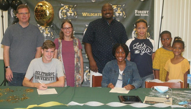 Front row, from left, Forest High's Ashton Deriso signed with Oglethorpe University and Nichole Harris signed with Georgia Southern University on Tuesday. Both athletes will compete in cross country and track at their respective schools. Back row, from left, father, Brian Deriso, mother, Lauren Ortiz. Iamfre Washington, father, Pelaur Harris, mother, Iamfre Washington Jr., brother, Zoe Washington, sister.