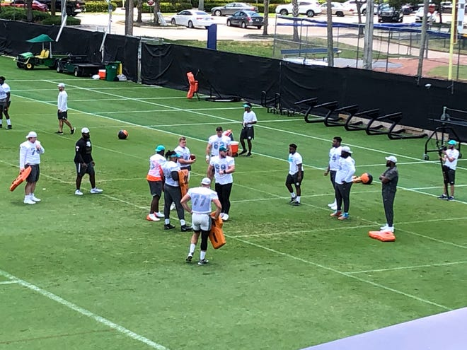 Dolphins players work out during Wednesday's OTA in Davie.