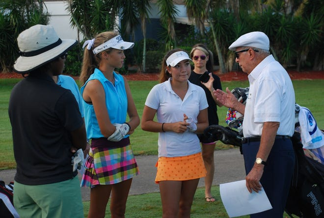 Hall of Fame golf teacher Bob Toski talks with players on the first tee during one of his previous youth golf tournaments.