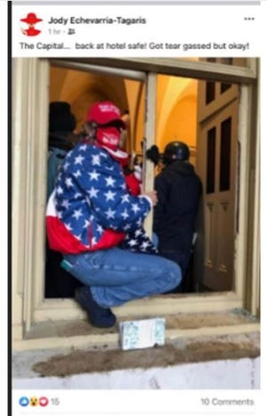 """This Facebook photo depicts a woman wearing a red Make America Great Again hat, an American Flag scarf, blue jeans, and a unique U.S. Olympics American flag jacket while masked posing in a frame of a broken window next to the Senate Wing Door at the US Capital with the caption, """"The Capital. . . .back at hotel safe! Got tear gassed but okay!""""."""