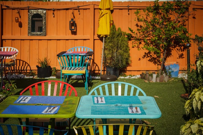 Outdoor seating at French Grill House in Northwood Village.