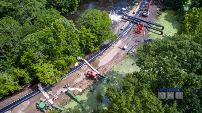 DPW is operating a total of six pumps, four 24-inch tractor pumps and two 30-inch axle driven pumps, at the Alligator Bayou Road pumping site.