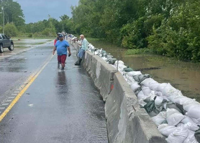 The combination of sandbags and cement barriers capped off a potential deluge of floodwater along La. 75 between Bayou Sorrel and Bayou Pigeon.