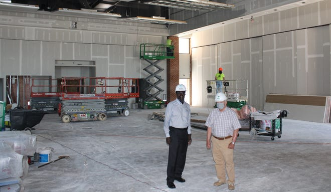 """From left to right, Director of Library Services Wayne M. Crocker and Petersburg Library Foundation Chairman Robert """"Bob"""" C. Walker stand in the Conference/Event Center Phase II addition at the Petersburg Public Library on May 18."""