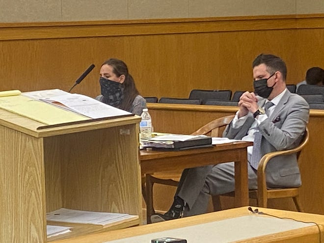 Christine Longo appears in District Court, Wakefield, on May 26. At right is her lawyer, Chad Bank.